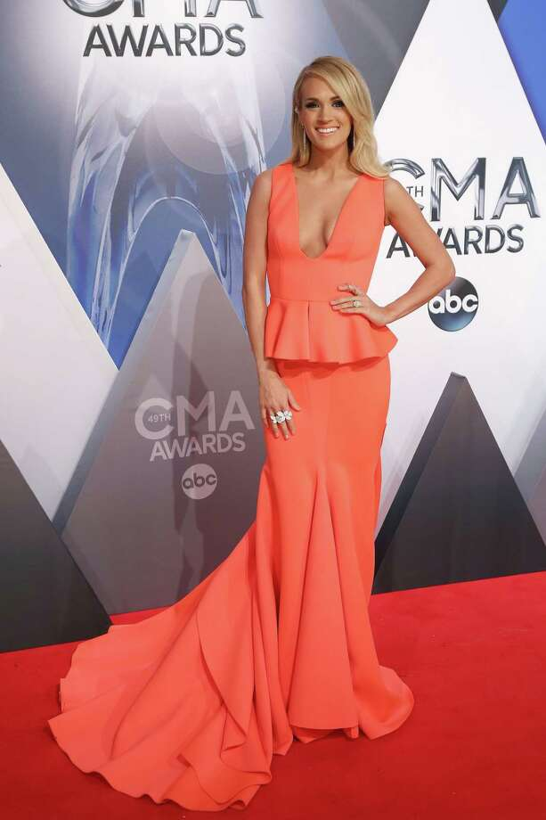 Celebrities rocked the red carpet at the CMA Awards Wednesday Nov. 5. Well, some rocked it and others fell short. Take a look at these fashion hits and misses.We love the front of Carrie's dress... Photo: Taylor Hill, Getty Images / 2015 Taylor Hill