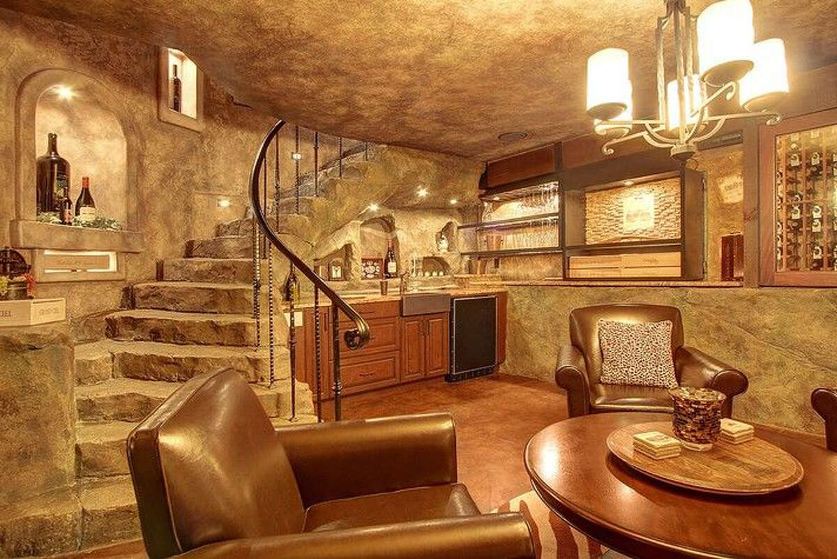 The home, which is listed for $2.2 million, includes a wine cellar with seating.