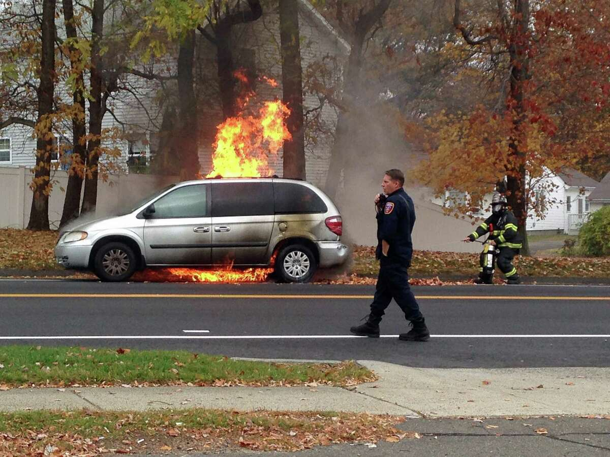 A car caught fire at Tunxis Hill Cut Off in Fairfield on Thursday, Nov. 5, 2015. Flames from the fire also ignited some roadside leaves. The mini-van was unoccupied when the fire broke out.