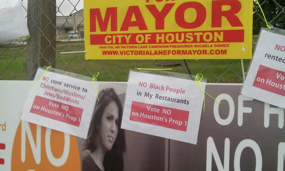 "Signs posted around Houston mocking the ""No Men in Women's Restrooms"" hysteria. Photo: Courtesy Of Koomah"
