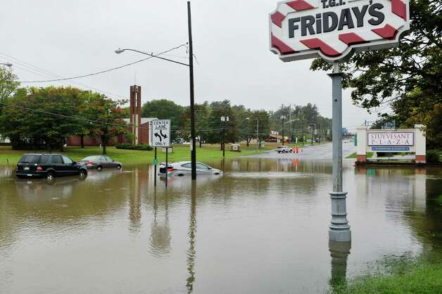 Several cars are seen stranded in a flooded section of Western Ave. just in front of Stuyvesant Plaza on Wednesday, Sept. 30, 2015, in Albany, N.Y.  (Paul Buckowski / Times Union) Photo: STAFF / 10033561A