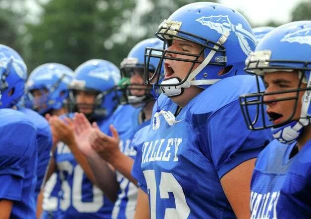Hoosic Valley High School's Dominic Smith, second from right, roots on his team as they play Corinth on Saturday Sept. 12, 2015 in Schaghticoke, N.Y.  (Michael P. Farrell/Times Union) Photo: Michael P. Farrell / 00033304B