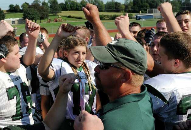 Greenwich kicker Linnea D'Acchille, center, shares team spirit after their football game against Hoosic Valley on Saturday, Sept. 19, 2015, at Hoosic Valley High in Schaghticoke, N.Y. (Cindy Schultz / Times Union) Photo: Cindy Schultz
