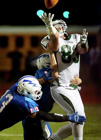 Shenendehowa's Michael Gillooley, right, bobbles a pass then secures the ball as Saratoga's Brandon Hiply, left, and Brian Williams defend during their football game on Friday, Sept. 25, 2015, at Saratoga Springs High in Saratoga Springs, N.Y. (Cindy Schultz / Times Union) Photo: Cindy Schultz / 10033490A