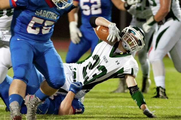 Shenendehowa's Griffin Wallner, center, is brought down by Saratoga's Brian Williams during their football game on Friday, Sept. 25, 2015, at Saratoga Springs High in Saratoga Springs, N.Y. (Cindy Schultz / Times Union) Photo: Cindy Schultz / 10033490A