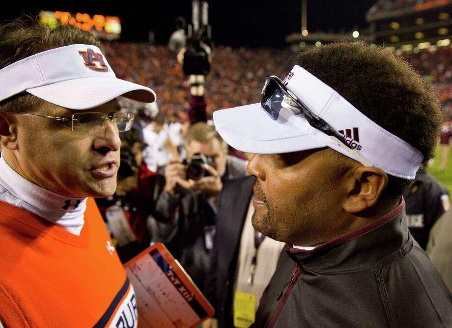 Texas A&M head coach Kevin Sumlin, right, and Auburn head coach Gus Malzahn meet after an NCAA college football game, Saturday, Nov. 8, 2014, in Auburn, Ala. Texas A&M won 41-38. (AP Photo/Brynn Anderson) Photo: Brynn Anderson, STF / AP