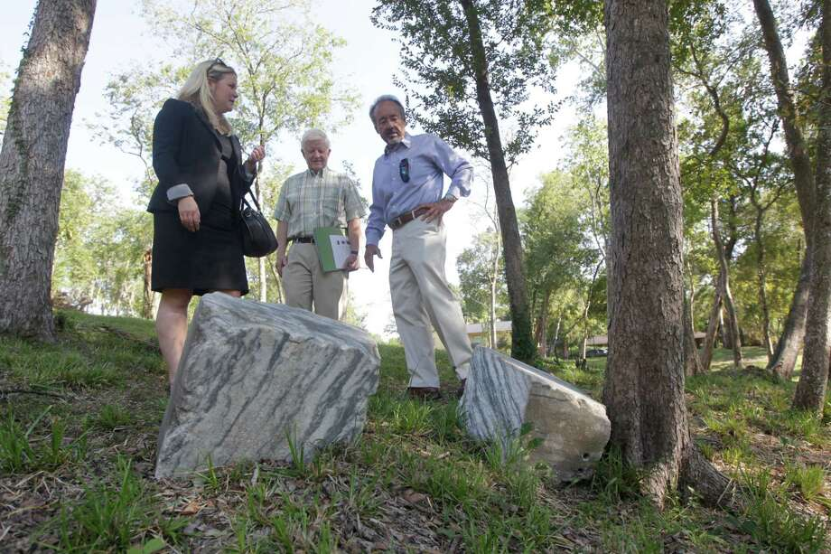 Kourtney Schroeder, Jay Tapp, and Darryl Schroeder explore an old cemetery behind the historic Weingarten mansion. Area residents have set up a nonprofit to maintain it. Photo: J. Patric Schneider, Freelance / © 2015 Houston Chronicle