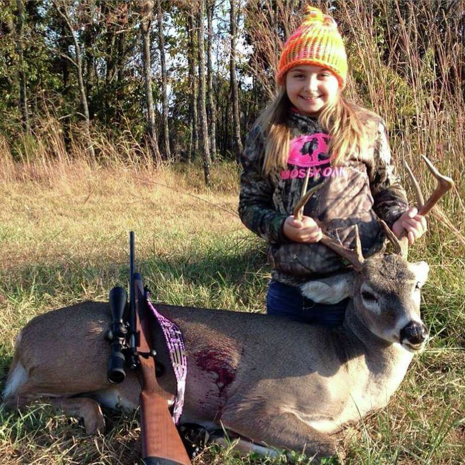 Emilee, age 9, almost 10, with her first buck.  Photo from: Bill Derrick