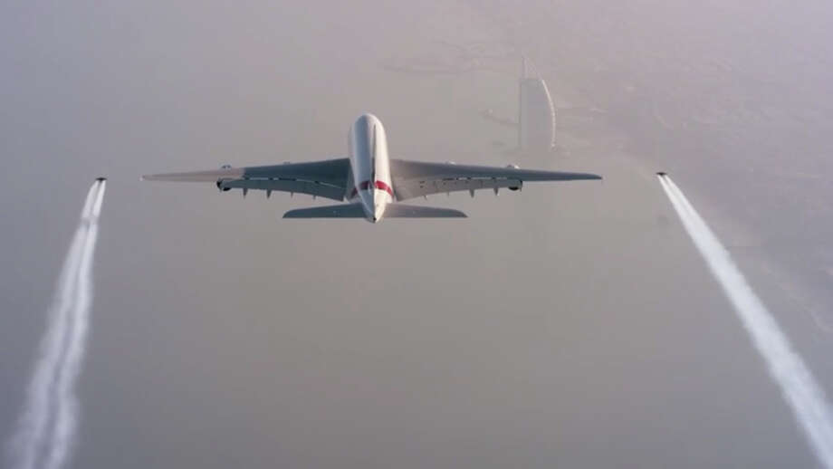 """A newly released video shows two """"jetmen"""" flying in formation with an Emirates A380 airliner. Photo: YouTube / XDubai"""