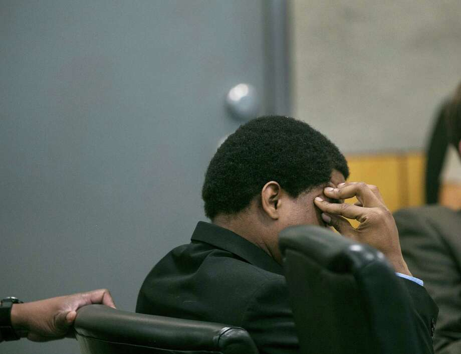 Rashad Owens puts his hand to head as Shon Cook identifies her daughter, Jamie West in a photo from her wedding day, as she testifies during Owens' trial, Tuesday, Nov. 3, 2015, in Austin, Texas.  Owens is charged with killing four people, including West, and injuring more than 20 others during the South by Southwest Music Festival in March 2014. He also faces 24 counts of aggravated assault with a deadly weapon. Those offenses will remain pending until after his trial. (Laura Skelding/Austin American-Statesman via AP)  AUSTIN CHRONICLE OUT, COMMUNITY IMPACT OUT, INTERNET AND TV MUST CREDIT PHOTOGRAPHER AND STATESMAN.COM, MAGS OUT; MANDATORY CREDIT Photo: Laura Skelding, Laura Skelding/Austin American-Statesman Via AP / Austin American-Statesman
