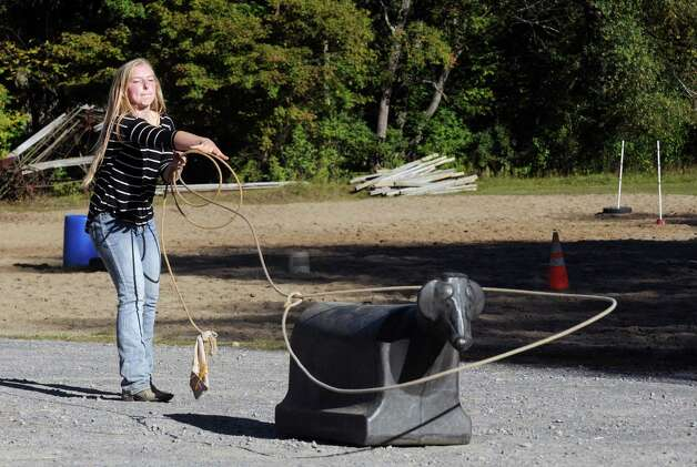 Seventeen-year-old Brittany Ryan practices her calf roping Wednesday Sept. 23, 2015 in Broadalbin, N.Y.  (Michael P. Farrell/Times Union) Photo: Michael P. Farrell / 00033426A