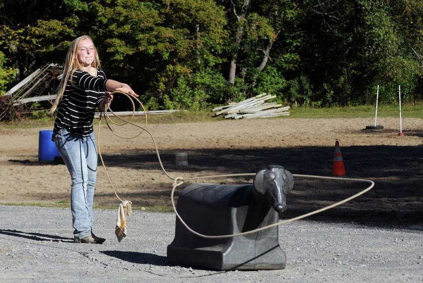 Seventeen-year-old Brittany Ryan practices her calf roping Wednesday Sept. 23, 2015 in Broadalbin, N.Y. (Michael P. Farrell/Times Union)