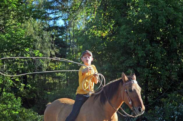 Fourteen-year-old Evan Meashaw practices his steer roping Wednesday Sept. 23, 2015 in Broadalbin, N.Y.  (Michael P. Farrell/Times Union) Photo: Michael P. Farrell / 00033426A