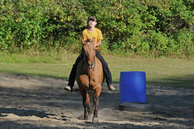Fourteen-year-old Evan Meashaw works with horse Dunny on obstacle riding Wednesday Sept. 23, 2015 in Broadalbin, N.Y.  (Michael P. Farrell/Times Union) Photo: Michael P. Farrell / 00033426A