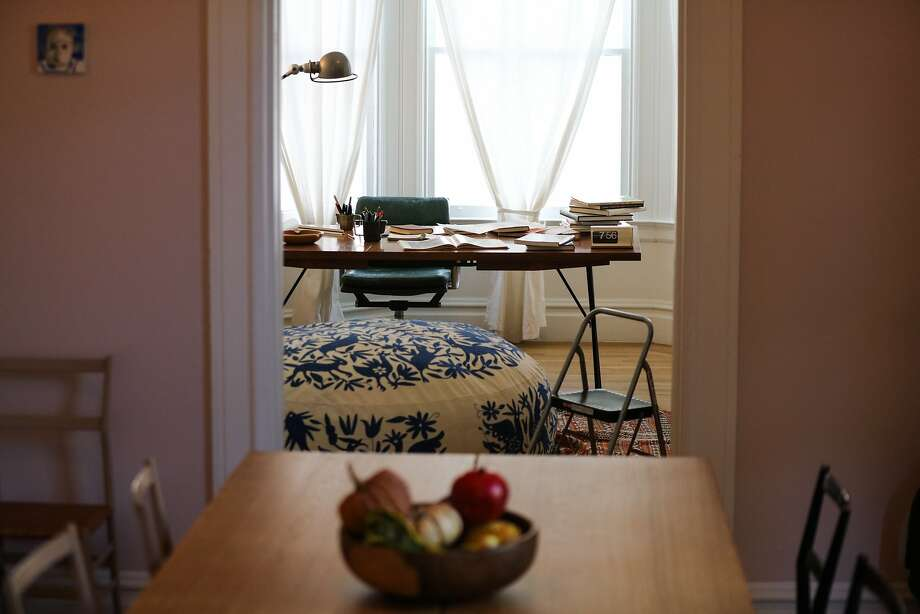Architect Brett Terpeluk's home office can be seen from his dining room at his Bernal Heights home. Photo: Gabrielle Lurie, Special To The Chronicle