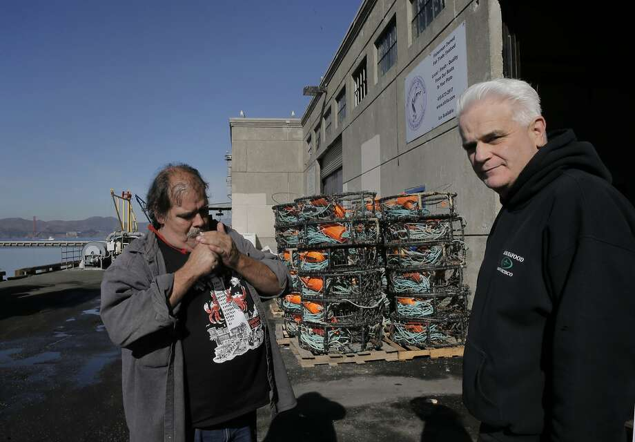 Larry Collins, (left) the president of the San Francisco Community Fishing Association, with local fish buyer Jude Smithson of Aloha Seafood, near crab pots on Pier 45 in San Francisco, Calif. on Thurs. November 5, 2015. Photo: Michael Macor, The Chronicle