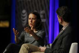 Anne Wojcicki (l to r), co-founder and CEO 23andMe, and Thomas Goetz, moderator and CEO Iodine, talk on stage at Navigate: The Atlantic Tech Conference 2014  at the Mission Bay Conference Center at UCSF on Tuesday, December 9, 2014 in San Francisco, Calif.