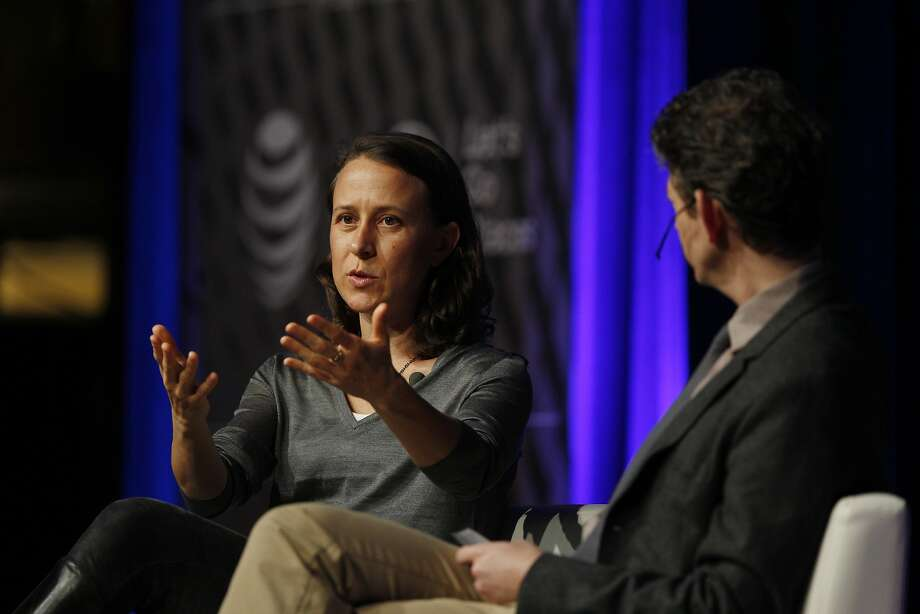 Anne Wojcicki (l to r), co-founder and CEO of 23andMe, and Thomas Goetz, moderator and CEO of Iodine, talk on stage at Navigate: The Atlantic Tech Conference 2014  at the Mission Bay Conference Center at UCSF on Tuesday, December 9, 2014. Photo: Lea Suzuki, The Chronicle