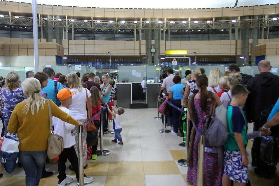 Tourists line up at airport check in Egypt's Red Sea resort of Sharm el-Sheikh. Britain and Ireland suspended air links over security concerns. Photo: Str, AFP / Getty Images