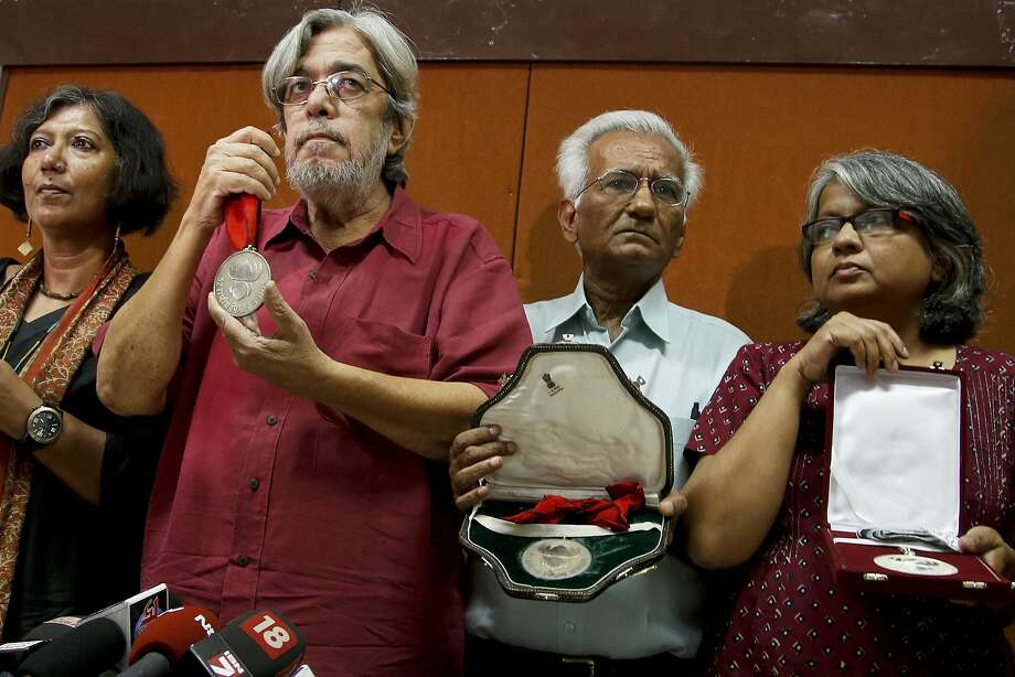 Bollywood film industry figures return National Film Awards before the media in Mumbai, to show their alarm over a climate of religious bigotry and violence across India. Photo: Rajanish Kakade, Associated Press