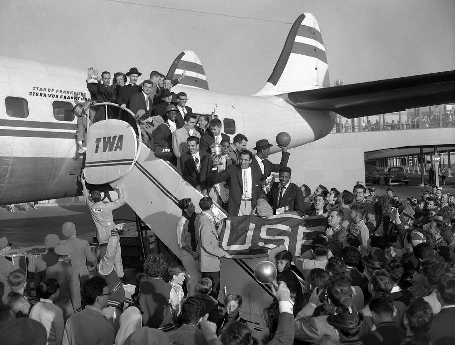 Fans welcome the USF basketball team back to San Francisco after the Dons won the NCAA basketball championship in 1955. Photo: Bill Young, The Chronicle