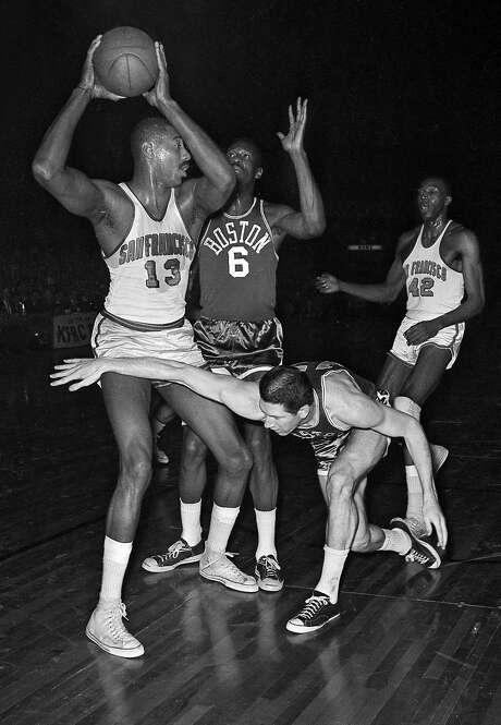 The San Francisco Warriors' Wilt Chamberlain goes up against former USF All-American Bill Russell of the Boston Celtics in a 1964 NBA playoff game. Photo: Bob Campbell, The Chronicle
