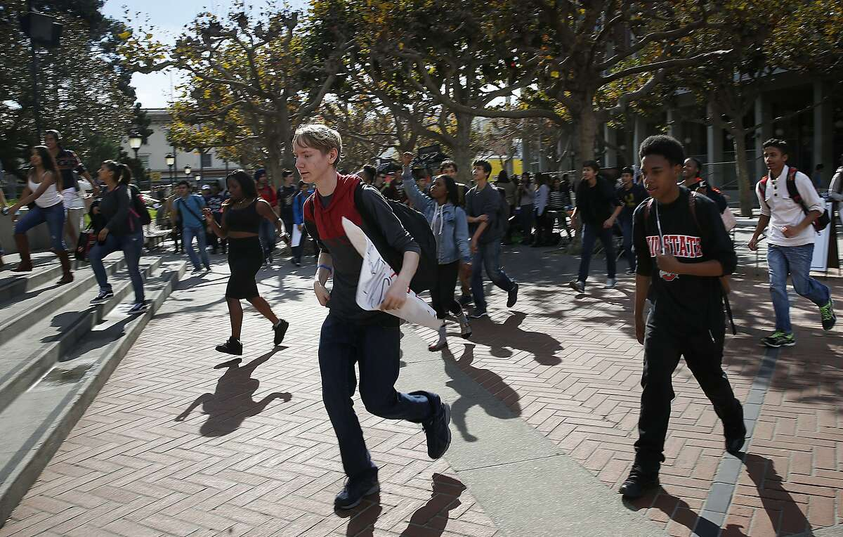 Berkeley High School students stage a walkout demonstration as the walk to Sproul plaza at UC Berkeley in Berkeley, Calif., on Thursday, November 5, 2015.