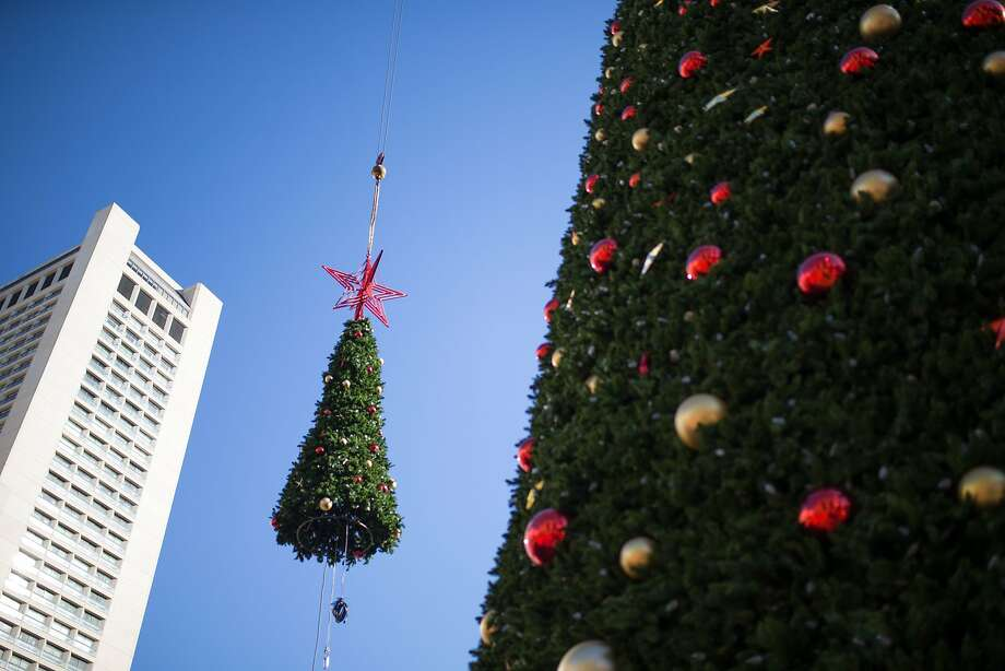 The star and the top tier of the Union Square Christmas tree is lifted by a crane on Thursday, Nov. 5, 2015 in San Francisco, Calif. Photo: Nathaniel Y. Downes, The Chronicle