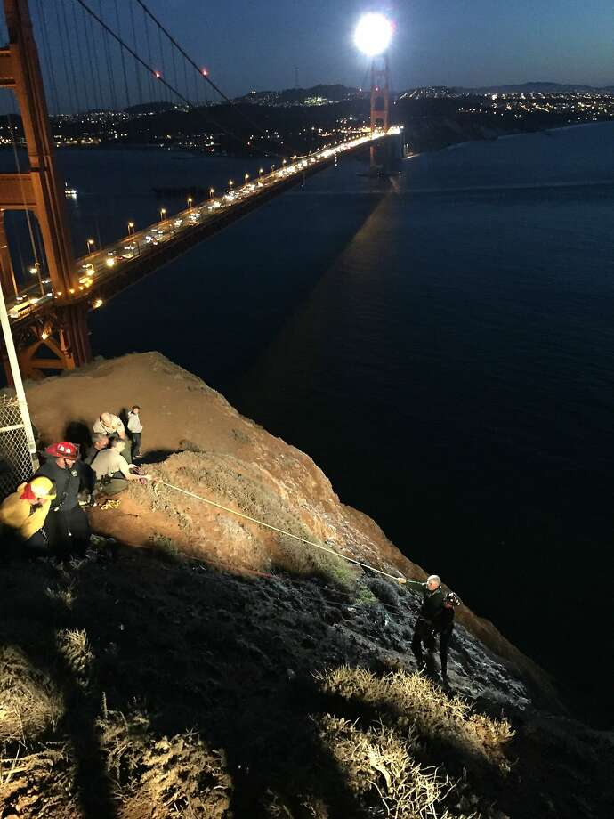 Marin County Firefighter Willie Krakauer rappelled down a cliff to save a fallen tourist Wednesday evening at the Battery Spence overlook on the north side of the Golden Gate Bridge. Photo: Mill Valley Fire Department