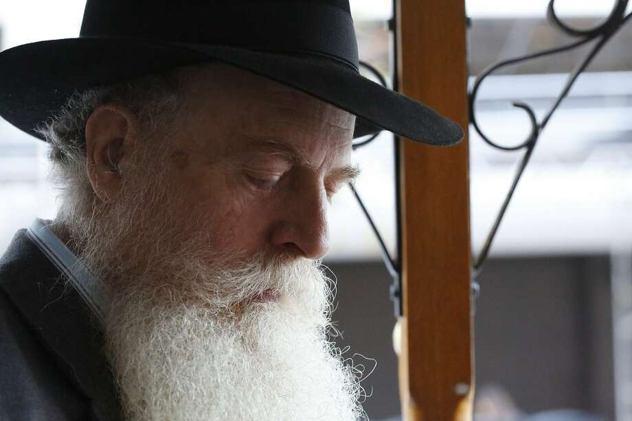 Rabbi Yosef Langer prays on the Mitzvah Cable Car in downtown San Francisco. Rabbi Langer started the Mitzvah Cable Car and now shares the responsibilities with his son Rabbi Moshe Langer. Photo: Kathleen Duncan, The Chronicle