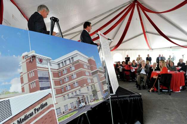 Norman Dascher, Jr., right, Chief Executive Officer, Samaritan and St. Mary's Hospitals, Vice President, Acute Care-Troy, St. Peter's Health Partners addresses those gathered for a ground breaking ceremony for the  St. PeterOs Health Partners Heinrich Medicus Pavilion on the Samaritan Hospital campus on Thursday, Nov. 5, 2015, in Troy, N.Y.  The pavilion is the centerpiece of SPHPOs $99 million Troy Master Facilities Plan.  (Paul Buckowski / Times Union) Photo: PAUL BUCKOWSKI / 00034089A