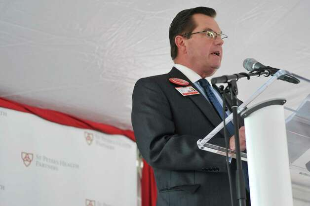 Norman Dascher, Jr., Chief Executive Officer, Samaritan and St. Mary's Hospitals, Vice President, Acute Care-Troy, St. Peter's Health Partners addresses those gathered for a ground breaking ceremony for the  St. PeterOs Health Partners Heinrich Medicus Pavilion on the Samaritan Hospital campus on Thursday, Nov. 5, 2015, in Troy, N.Y.  The pavilion is the centerpiece of SPHPOs $99 million Troy Master Facilities Plan.  (Paul Buckowski / Times Union) Photo: PAUL BUCKOWSKI / 00034089A