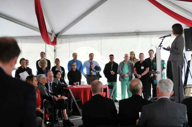 Guests look on as Kathy Jimino, Rensselaer County Executive, addresses them at a ground breaking ceremony for the  St. PeterOs Health Partners Heinrich Medicus Pavilion on the Samaritan Hospital campus on Thursday, Nov. 5, 2015, in Troy, N.Y.  The pavilion is the centerpiece of SPHPOs $99 million Troy Master Facilities Plan.  (Paul Buckowski / Times Union) Photo: PAUL BUCKOWSKI / 00034089A