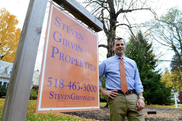 Independent realtor Steven Girvin stands in front of one of his recent listings in Loudonville on Chestnut Hill North Friday, Oct. 30, 2015, in Colonie N.Y. (Will Waldron/Times Union) Photo: Will Waldron / 00033999A