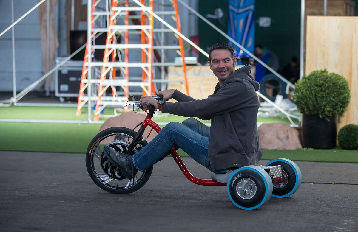 Brent Bushnell, CEO for Two Bit Circus, rides a custom electric big wheel at the pier 48 where STEAM carnival, an amusement park to get kids of all ages interested in math, science and making, is being constructed on Thursday, Nov. 5, 2015 in San Francisco, Calif.
