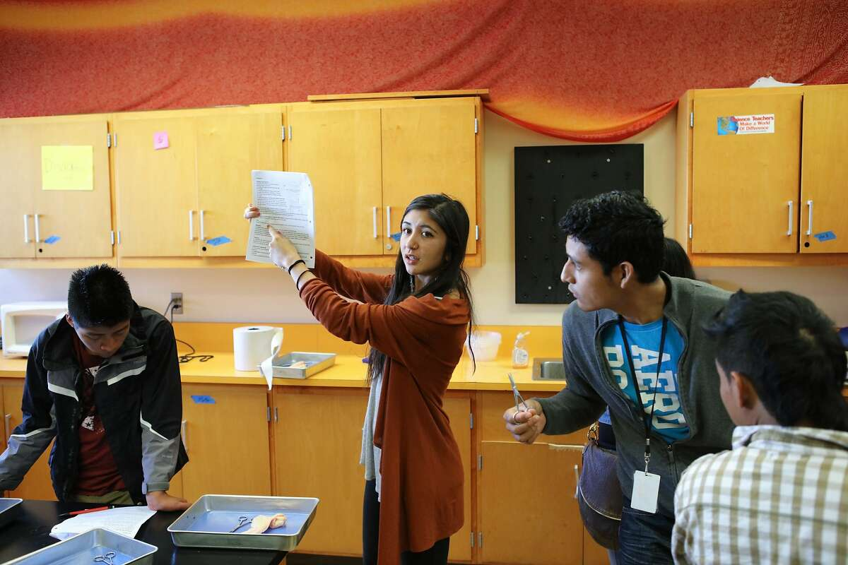 Mrs. Quinn (center) instructs her students how to fill out their science charts during a dissection in her physiology class at Fremont High School in Oakland, California on Thursday, November 5, 2015.