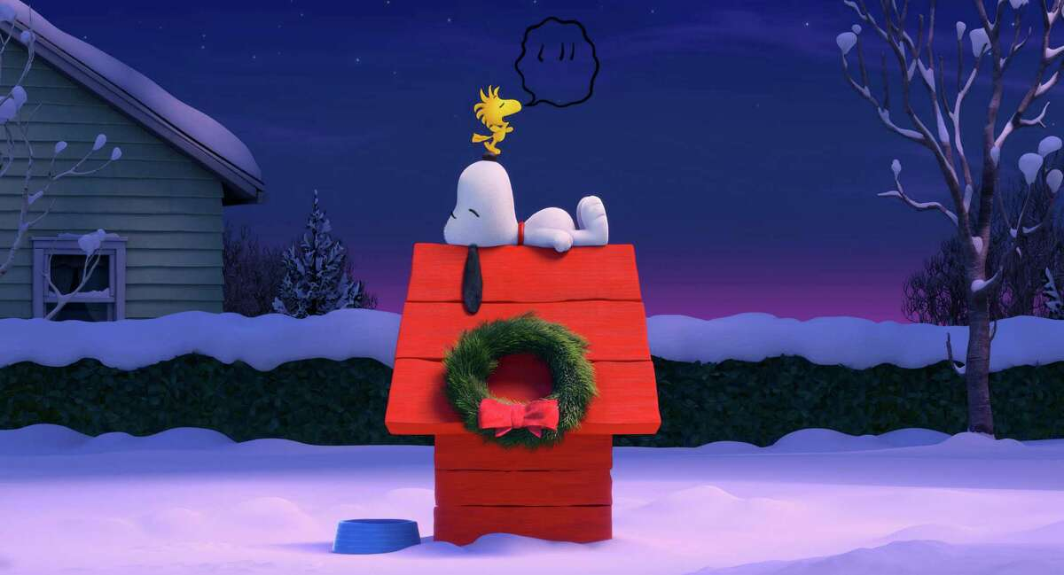 In this photo provided by Twentieth Century Fox & Peanuts Worldwide LLC, before their next big airborne adventure, Snoopy and Woodstock have a quiet moment in the new film,