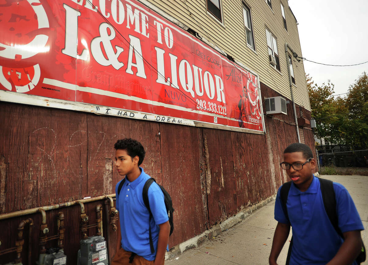 Harding High students Bryan Merchant, 14, left, and Isaiah Wilson, 15, of Bridgeport, at the intersection of Hollister and Stratford Avenues in the East End of Bridgeport on Tuesday. The neighborhood has been the scene of ongoing gang related shooting incidents in recent weeks.