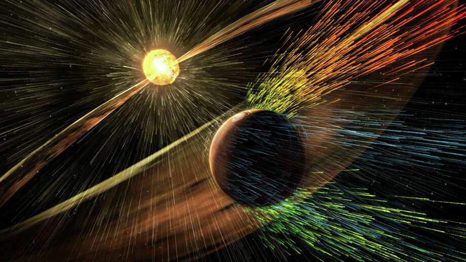 An artist's rendering shows a solar storm hitting Mars and stripping ions from the planet's upper atmosphere. NASA's Mars-orbiting MAVEN craft has discovered that solar storms rob the red planet of about 10 pounds of atmosphere per second. Photo: HOGP / Goddard Space Flight Center/NASA