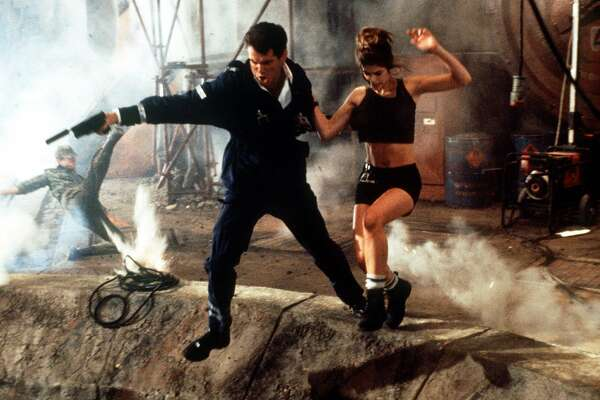 (007 - James Bond)   THE WORLD IS NOT ENOUGH --Pierce Brosnan, left, starring as James Bond, and Denise Richards, as Dr. Christmas Jones, appear in a scene from the MGM action film, 'The World is Not Enough,' opening in theaters on Friday, Nov. 19, 1999. The film is the 19th installment of the long-running Bond series and most successful film franchise in history. (AP Photo/Danjaq LLC and United Artists, Keith Hamshere)