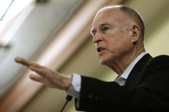 FILE - In this Wednesday May 27, 2015 file photo, California Gov. Jerry Brown addresses a conference in Sacramento, Calif. Brown directed state oil and gas regulators to investigate the oil and gas potential of his family's ranch land in Northern California, state records obtained by the Associated Press show. Brown saved himself the $200 to $400 hourly cost of hiring a geologist to determine if there was money to be made from his family's mineral deposits, and may have violated state law on diverting public employees and other resources for personal purposes. (AP Photo/Rich Pedroncelli, File)