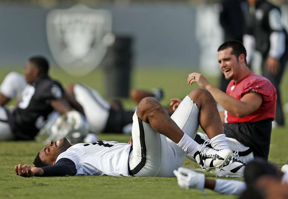 Oakland Raiders' Michael Crabtree (left) and Derek Carr are making a connection as quarterback and receiver. Photo: Scott Strazzante, The Chronicle