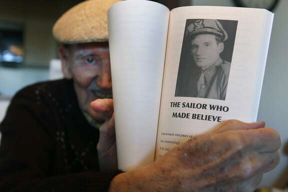 Jack Beritzoff holds a photograph of himself as a 22-year-old, published in a book he wrote about his life as a merchant seaman during World War II, at his home in San Rafael, Calif. on Thursday, Nov. 5, 2015. Beritzoff has long been seeking official acknowledgment from the federal government for the service of merchant seamen during the war years.