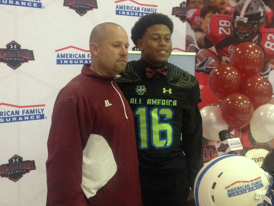 Central's Devwah Whaley along with Jaguars coach Toby Foreman, pose for a picture during a ceremony inviting the star running back to participate in the Under Armour All-American game Thursday. Photo: David Thompson