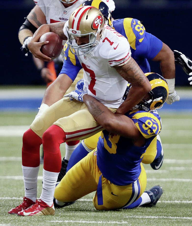 Bench-bound quarterback Colin Kaepernick has been sacked, on average, more than three times per game this season. Photo: Tom Gannam / Associated Press / FR45452 AP