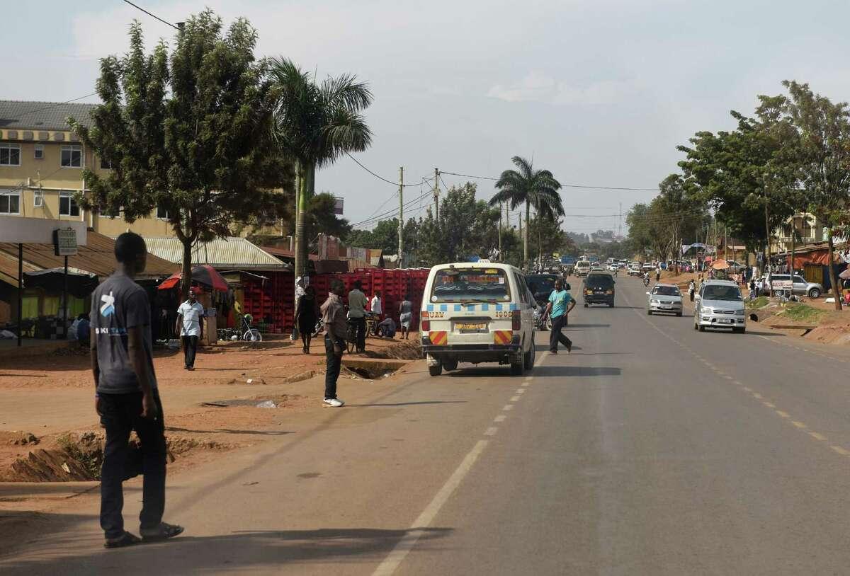 Activity buzzes on the streets of Kampala, Uganda.