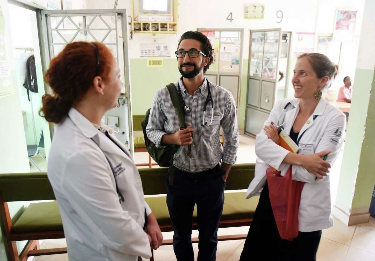 Dr. Sohi Ashraf, of Norwalk, Conn., with University of Vermont first-year medical students Mary-Kate LoPiccolo, left, of Newtown, Conn., and Alexandra Miller at St. Stephen's Hospital in the Mpererwe village of Kampala, Uganda.