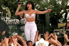 Jennifer Lopez playing Selena performs during the filming of the Monterray concert scene in Poteet today. Area residents were used as extras for the crowd at the concert. FOR METRO THELMA 10-19-96