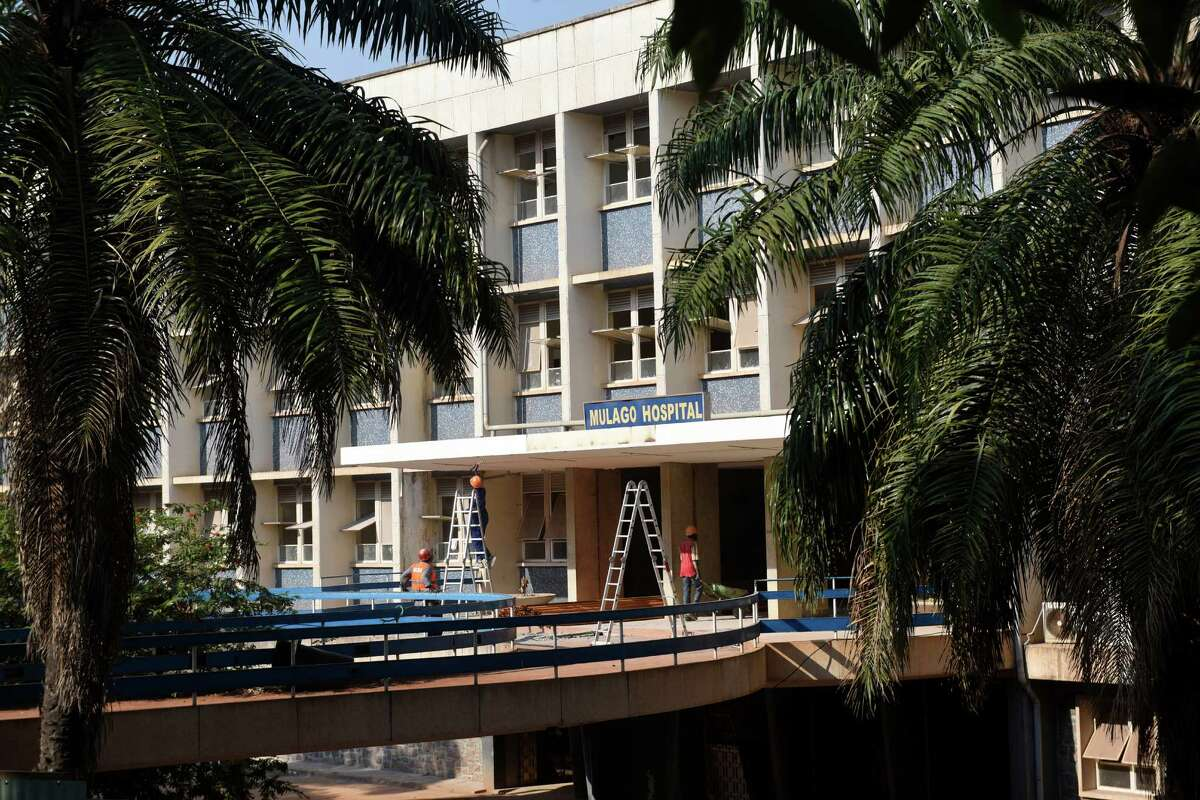 Construction workers work on renovations to the main entrance of Mulago Hospital in the capital city of Kampala, Uganda. Much of the hospital, including the main entrance, was closed for renovation and is estimated to be completed by the end of 2016.