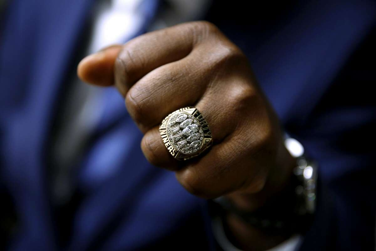 Former 49ers running back Ricky Watters shows off his Super Bowl 29 ring in San Francisco, California, on Wednesday, Nov. 4, 2015.